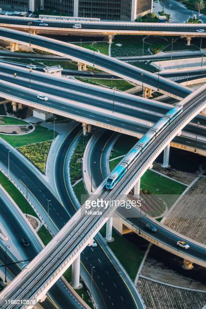 highway intersection and metro train in dubai, uae - underground station stock pictures, royalty-free photos & images