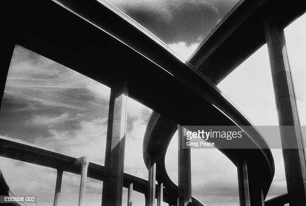 Highway intersection, elevated routes, low angle view (B&W)