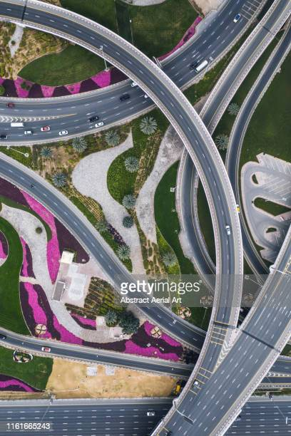 highway intersection from aerial perspective, dubai, united arab emirates - road junction stock pictures, royalty-free photos & images