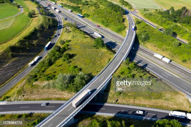 highway junction, aerial view - motorway stock pictures, royalty-free photos & images