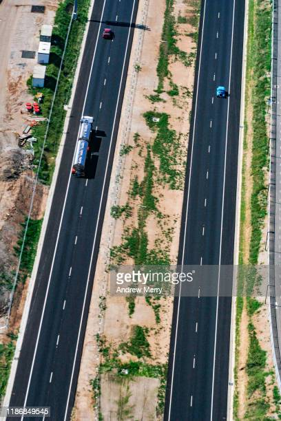 highway, main road on edge of city, urban sprawl in sydney, australia, aerial photography - parallel stock pictures, royalty-free photos & images