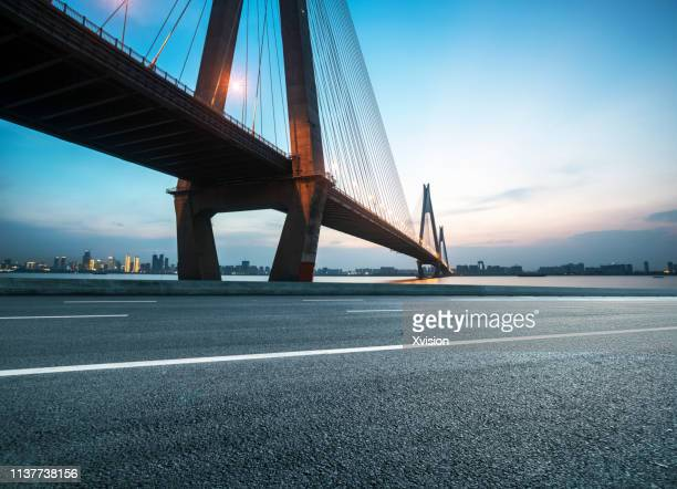 "highway near bridge in dusk for car commercial""n - wuhan stock photos and pictures"