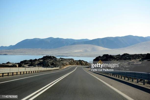 highway near caldera, chile - caldera stock pictures, royalty-free photos & images