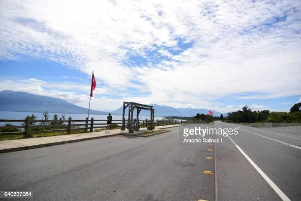 highway near puerto varas at the board of llanquihue lake - formación de roca stock pictures, royalty-free photos & images