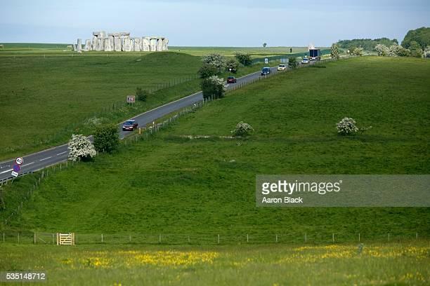 highway near stonehenge, england - stonehenge stock pictures, royalty-free photos & images