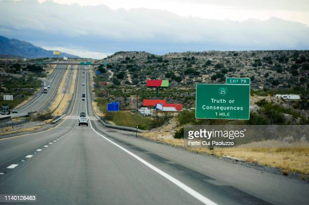 highway near truth or consequences, new mexico, usa - billboard highway stock pictures, royalty-free photos & images
