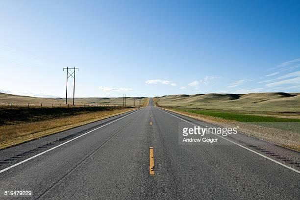 POV of highway on prairie.
