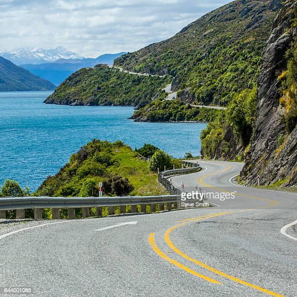 Highway on remote mountains near lake, Queenstown, Otago, New Zealand