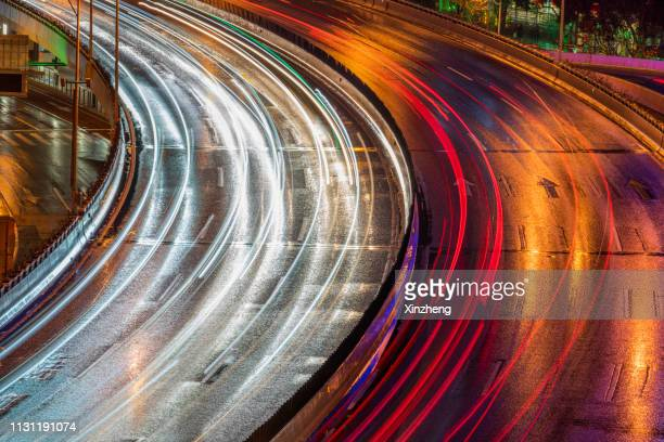 highway or autobahn at night. long exposure, aerial view - driverless car stock pictures, royalty-free photos & images