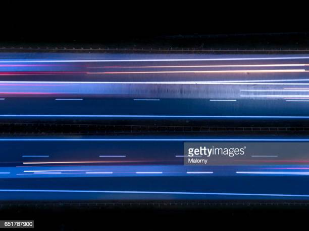 highway or autobahn at night. long exposure, top view. - strom stock-fotos und bilder