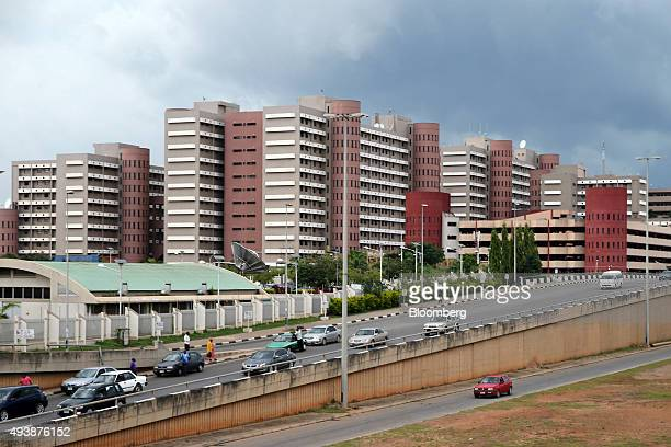 A highway passes a development of new residential buildings in Abuja Nigeria on Wednesday Oct 21 2015 A drop in crude prices in the past year has put...