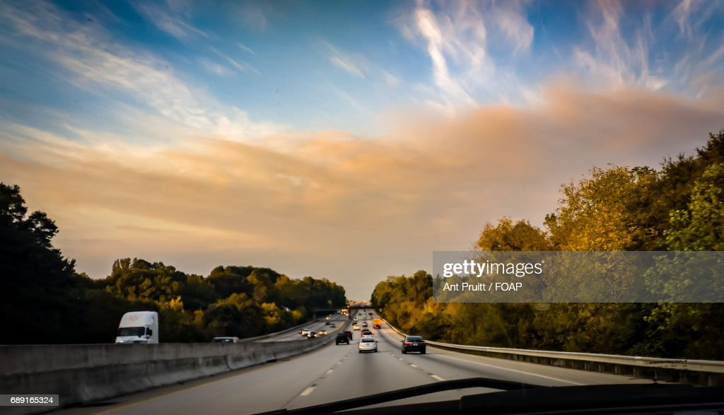 Highway passing through trees : Stock Photo