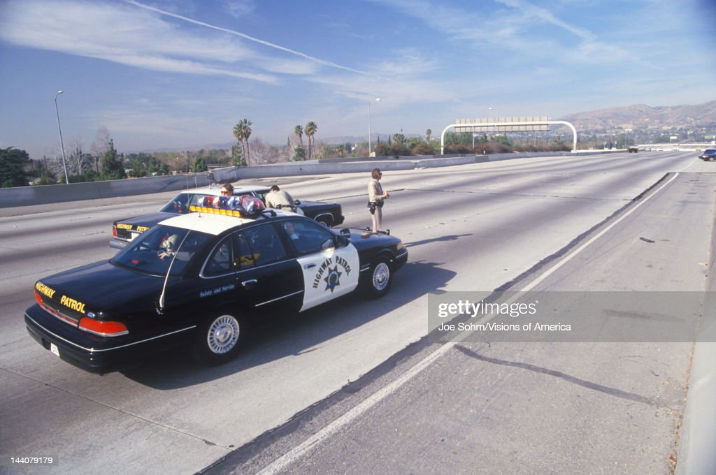 Highway Patrol on earthquake damaged freeway, Los Angeles, California : News Photo