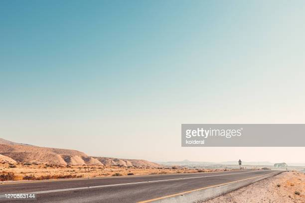 highway road in desert - desert stock pictures, royalty-free photos & images