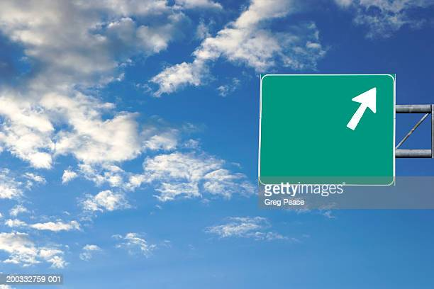 highway sign against blue sky with clouds (digital composite) - road sign stock pictures, royalty-free photos & images