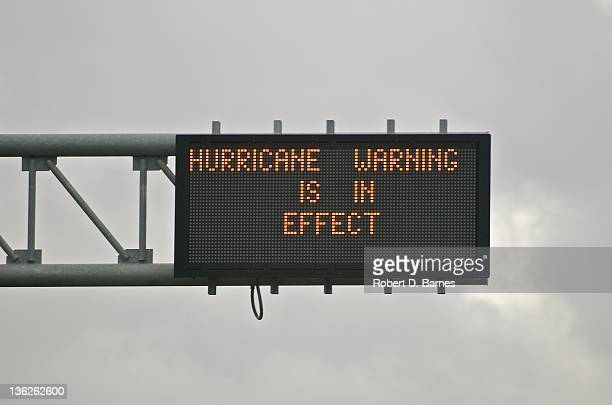 highway sign displaying hurricane warning - road sign stock pictures, royalty-free photos & images