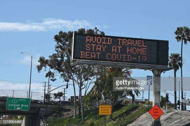 covid-19 highway sign - covid-19 stock pictures, royalty-free photos & images