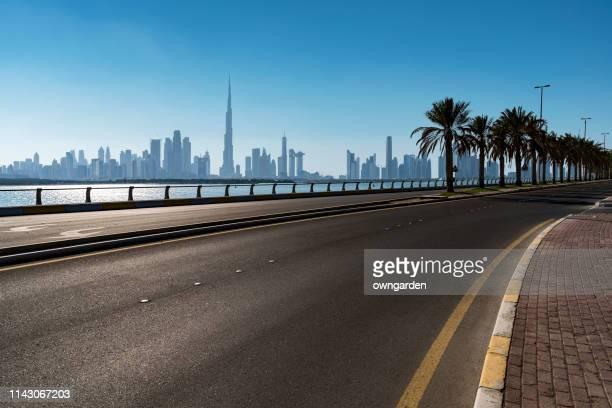 highway traffic in dubai, united arab emirates - international landmark stock pictures, royalty-free photos & images