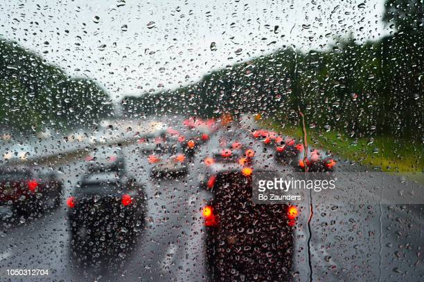 Highway traffic jam on a day of heavy rain, as seen from the top front seat of double dedcker Megabus.bus.