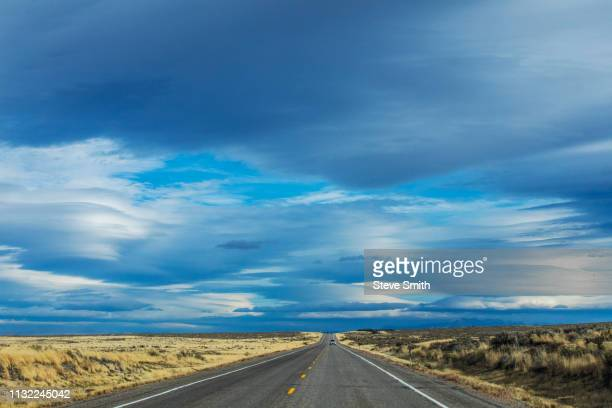 highway under clouds - idaho falls stock pictures, royalty-free photos & images