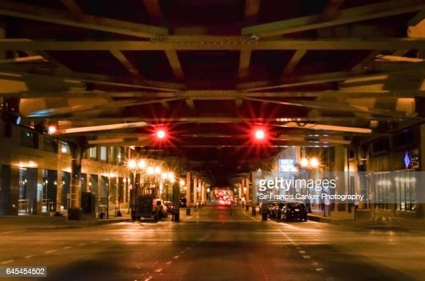 Highway underneath Chicago subway or metro at night, Illinois, USA
