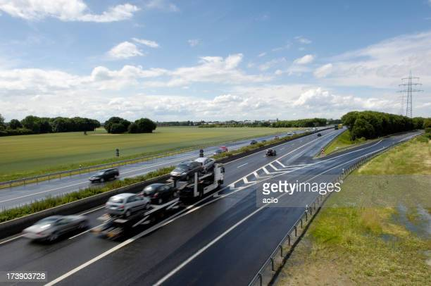 Highway with car transporter and other cars