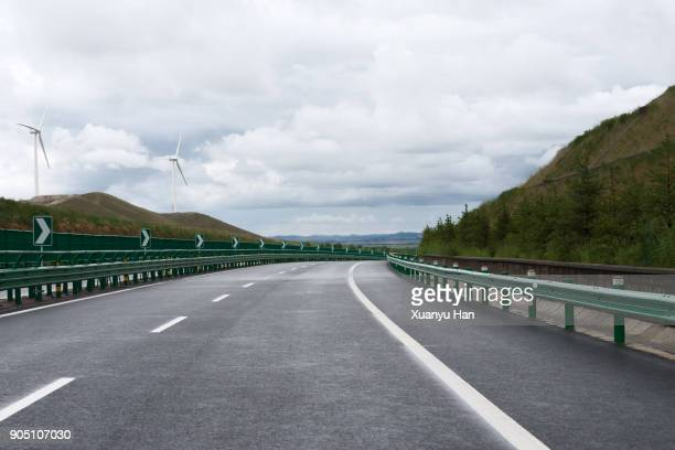 highway with guard rail - railing stock pictures, royalty-free photos & images