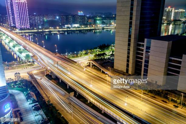 Highway with light trails and bridge over river at night, Fuzhou, Fujian, China
