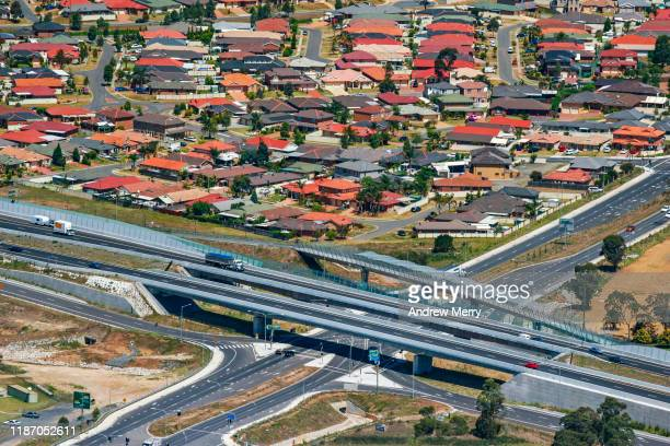 highway with overpass main road and houses in suburb, cityscape, urban sprawl in sydney, australia, aerial photography - housing difficulties stock pictures, royalty-free photos & images