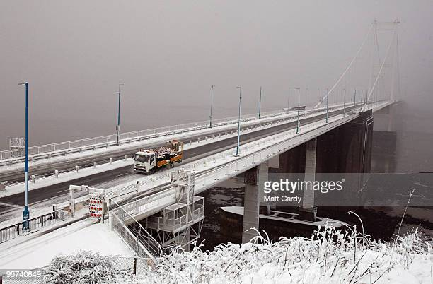 A highways agency lorry drives along the M48 motorway leading from the Severn Bridge which has been closed due to adverse weather on January 13 2010...