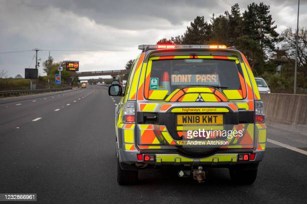 Highways England enforcement officer stops all traffic using a DO NOT PASS sign on the south bound lane of the M1 motorway somewhere near...