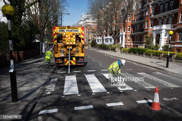 Highways Maintenance team takes advantage of the COVID19 coronavirus lockdown and quiet streets to repaint the iconic Abbey Road crossing on March 24...