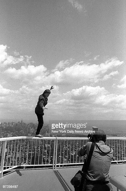 Highwire artist Philippe Petit shows catlike balance at edge of World Trade Center roof