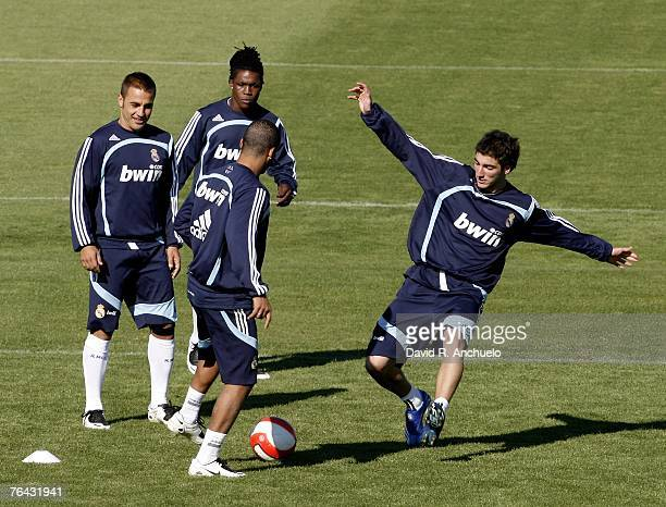 Higuain vies with Marcelo while Cannavaro and Drenthe watch them during a training session at Real's Valdebebas sports facility on August 31 2007 in...
