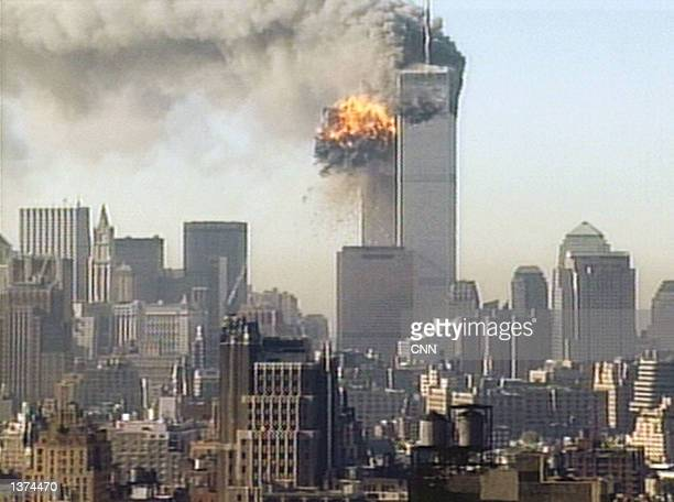 Hijacked United Airlines flight 175 is flown into the south tower of the World Trade Center September 11, 2001 in New York City. The plane is one of...