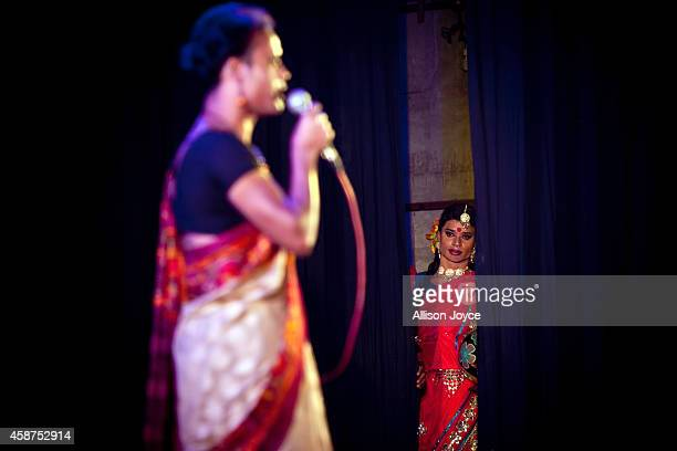 Hijra or transgender watches a performance backstage at the Hijra talent show part of the first ever event called Hijra Pride 2014 on November 10...