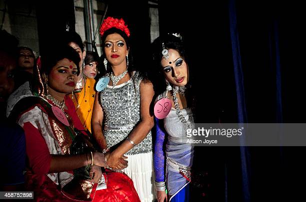 Hijras or transgenders watch a performance backstage at the Hijra talent show part of the first ever event called Hijra Pride 2014 on November 10...