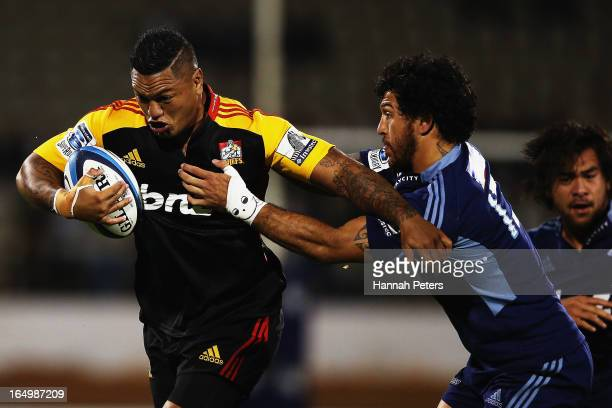 Hika Elliot of the Chiefs fends off Rene Ranger of the Blues during the round seven Super Rugby match between the Chiefs and the Blues at Bay Park on...
