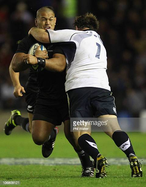 Hika Elliot of the New Zealand All Blacks is tackled by John Barclay of Scotland during the Test match between New Zealand and Scotland at...
