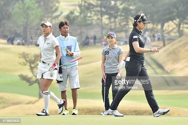 Hikari Fujita Momoko Ueda and Asuka Kashiwabara of Japan walk on the fairway during the second round of the Studio Alice Open at the Hanayashiki Golf...