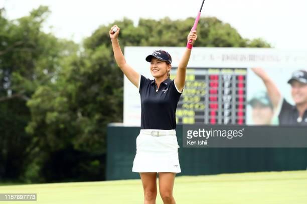 Hikari Fujita of Japan celebrates winning the tournament on the 18th green during the final round of the Yupiteru Shizuoka Shimbun SBS Ladies at...