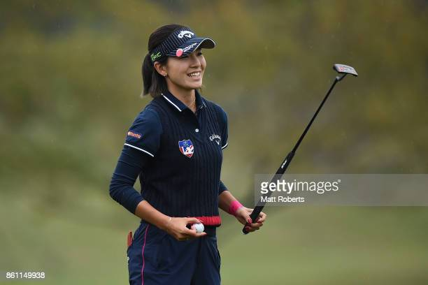 Hikari Fujita of Japan reacts after her putt on the 18th green during the second round of the Fujitsu Ladies 2017 at the Tokyu Seven Hundred Club on...