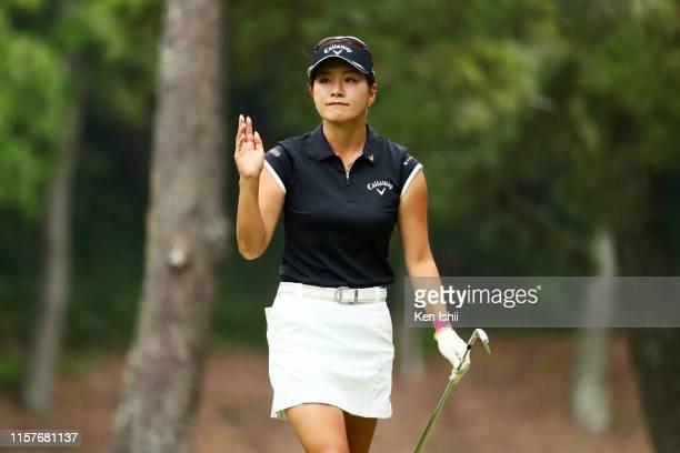 Hikari Fujita of Japan reacts her tee shot on the 4th hole during the final round of the Yupiteru Shizuoka Shimbun SBS Ladies at Shizuoka Country...
