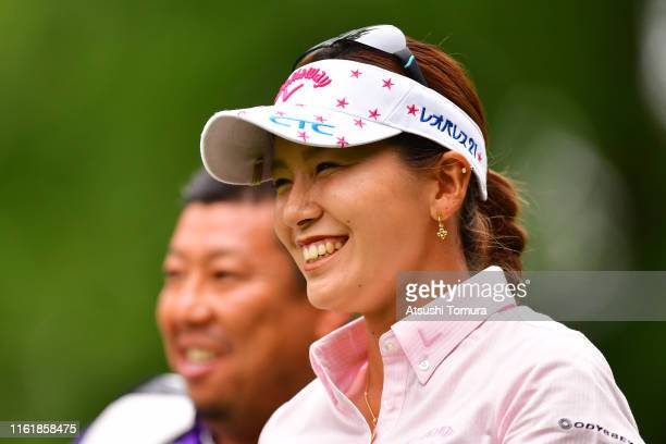 Hikari Fujita of Japan smiles after her tee shot on the 10th hole during the final round of the Nippon Ham Ladies Classic at Katsura Golf Club on...