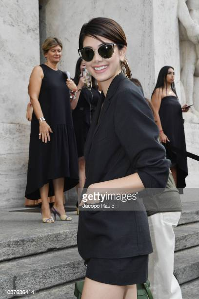 Jeremy Irvine Ellie Bamber Elizabeth Chambers Armie Hammer and a guest attend the Salvatore Ferragamo show during Milan Fashion Week Spring/Summer...