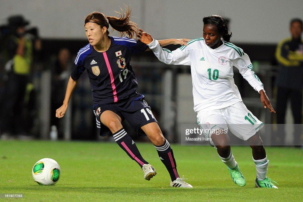 Hikari Nakade #16 of Japan and Ngozi Okobi #10 of Nigeria compete for the ball during the Women's international friendly match between Japan and Nigeria at Fukuda Denshi Arena on September 26, 2013 in Chiba, Japan.