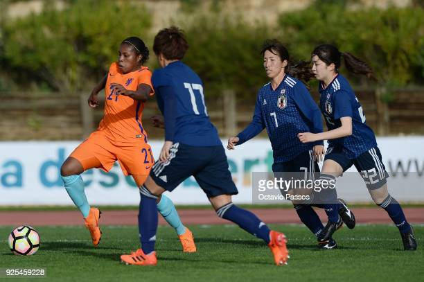Hikari Takagi of Japan competes for the ball with Lineth Beerensteyn of Holland during the Women's Algarve Cup Tournament match between Japan and...