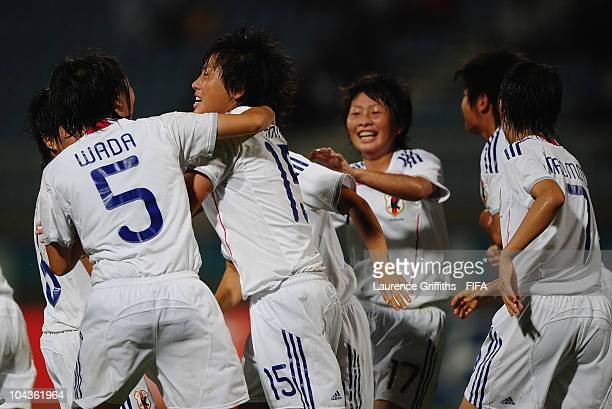 Hikari Takagi of Japan is congratulated on her goal during the FIFA U17 Women's World Cup Semi Final match between North Korea and Japan at the Ato...