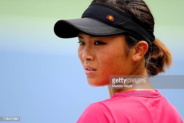 Hikari Yamamoto of Japan looks on during her girls' singles first round match against Barbora Krejcikova of Czech Republic on Day Nine of the 2013 US...
