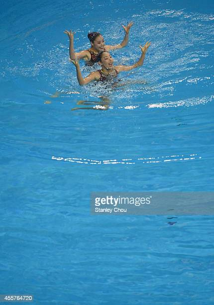 Hikaru Kazumori and Risako Mitsui of Japan performs during the Synchronised Swimming Duet Free Routine Final during day one of the 2014 Asian Games...